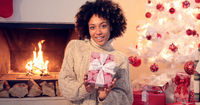 Close up of beautiful black woman holding present