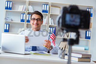 Businessman doing webcast with blank sheet of paper