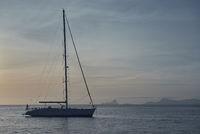 Yacht at Cala Saona in Formentera at sunset. Spain