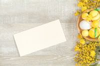 Easter holiday composition in yellow colors with spring flowers