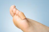 Closeup of a plaster on female toe