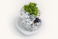 Meat with vegetables baked in aluminum foil