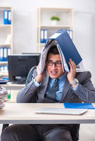 Overloaded with work employee under paperwork burden