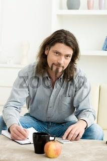 Man using digital calculator