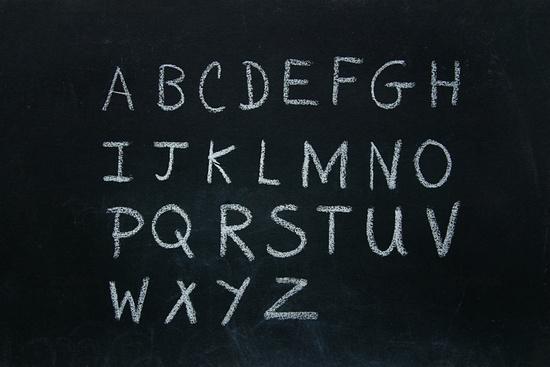 Alphabet letters written in chalk