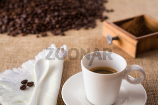 Coffee with coffee-beans on jute