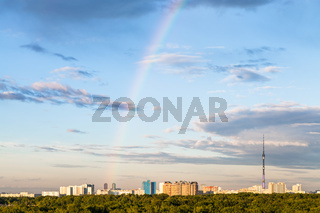 rainbow in evening sky over residential district