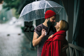 guy and girl under an umbrella