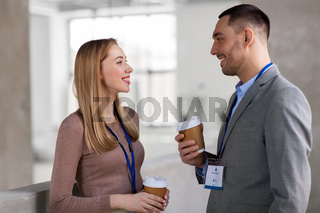 businesswoman and businessman at coffee break