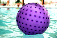 Lilac waterball floating on the water in a spa