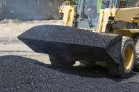 Excavator construct asphalt road and railroad lines