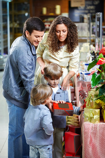 Happy family with children choose gifts