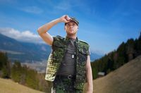 soldier in military uniform outdoors