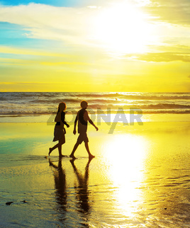 Couple walk on the beach