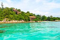 Heavenly green tropical island coast and small sand beach with clear sea