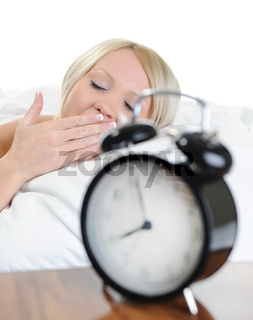 Sleepy woman turns off the alarm
