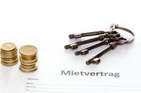 Münzen und Mietvertrag
