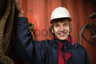 Young worker in white hardhat