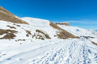 The landscape of snow-covered Caucasian rocks on the Gumbashi Pass.