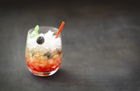 Blueberry cocktail with ice decorated by mint