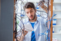 Computer repairman working on repairing network in IT workshop