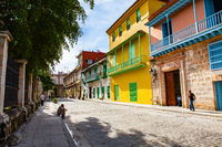 Havana, Cuba - December 12, 2016: Local people in the streets of Old Havana/Cuba with its colourful houses.