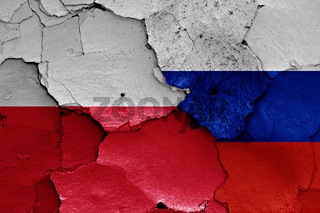 flags of Poland and Russia painted on cracked wall