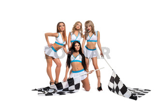 Sexy girls in formula one race style keeping flags