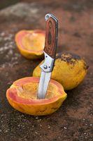 Tasty papayas and knife