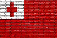 flag of Tonga painted on brick wall