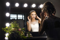 Portrait of young bride near mirror
