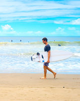 Man walk surfboard surfing beach