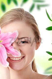 Beautiful blond woman with lily flower