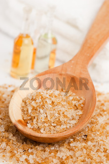 Spa essentials (bath salt in a spoon and bottles with oil)