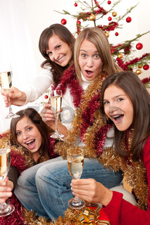Four young woman having fun on Christmas