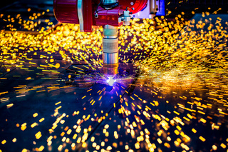 CNC Laser plasma cutting of metal, modern industrial technology. .