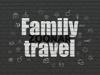 Tourism concept: Family Travel on wall background