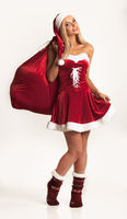 Girl in santa claus costume with gift bag