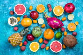 Exotic fruits on vibrant concrete slate,flat lay