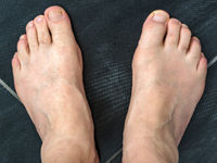 Naked feet of a man 60+