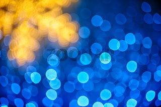 Blurred snowflake and blue lights