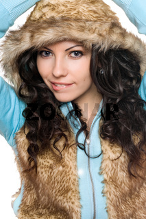 Portrait of playful brunette in the hood. Isolated