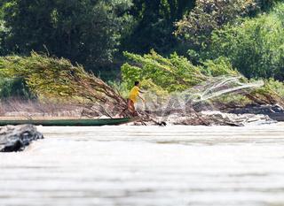 Fishermen with net on Mekong