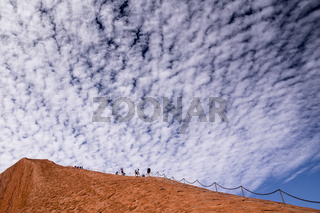 Tourists climbing Uluru Ayers Rock