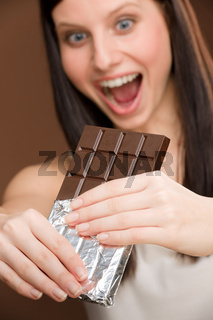 Chocolate - portrait young woman bite sweets