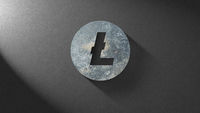 Icon litecoin made of stone on a dark background. Concept Blockchain, cryptocurrencies