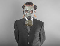 Businessman with mask, concept business dangerous for the environment or for society