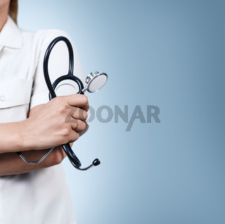 Stethoscope close-up in doctor's hands.