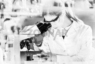 Female health care researchers working in scientific laboratory.