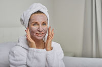 Woman at a spa with a face mask